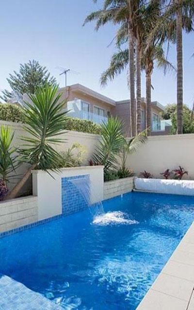 Piscina con cascada espool piscinas - Piscinas con cascadas ...